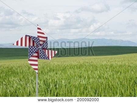 Digital composite of USA wind catcher in front of grass and sky