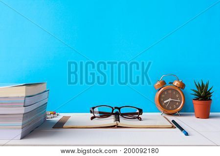 Books And Glasses On A White Wooden Table Are Clocks And Decorations With A Room
