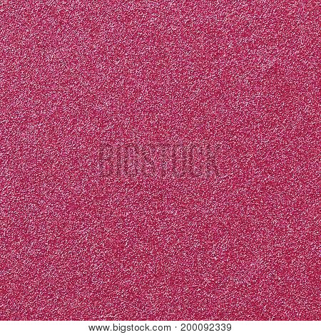 A digitally created pink glitter paper background texture.