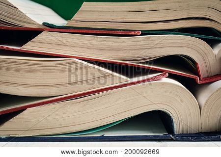 Old Books Open On Table At The Library