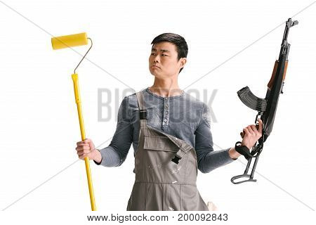 Construction Worker With Rifle And Roller Brush