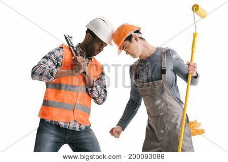 Confrontation Of African-american And Asian Builders