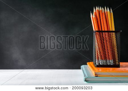 Book And Pencil On White Table Black Board Background With Study And Education