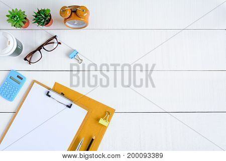Flat Lay Office Equipment On A White Wood Desk