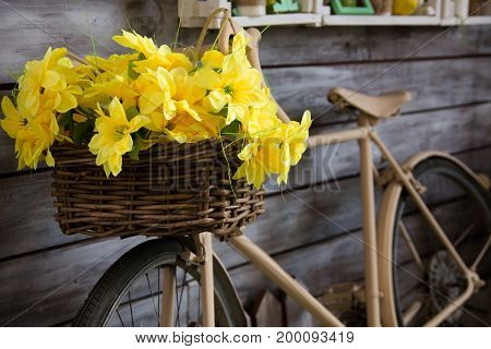 Close-up Of Yellow Flowers In A Basket On A Bicycle