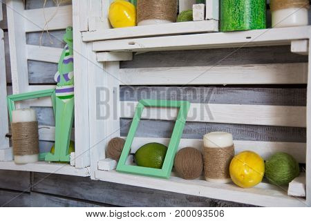 Wooden Shelf With Tangles Of Yarn And Lemons