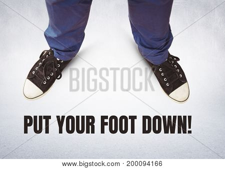 Digital composite of Put your foot down text and Black shoes on feet with grey background