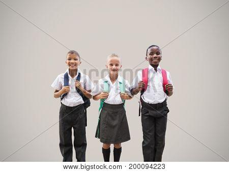 Digital composite of School kids in front of grey background