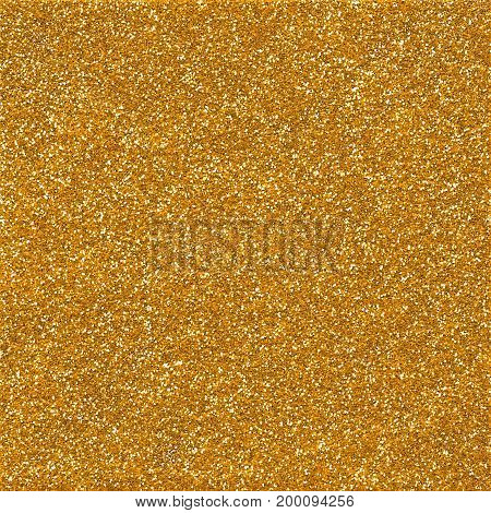 A digitally created golden glitter paper background texture.