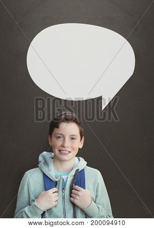 Digital composite of Student boy with speech bubble against grey background