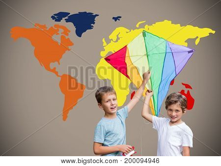 Digital composite of Kids holding kite in front of colorful world map