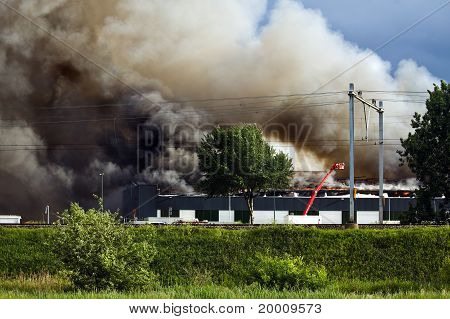 Firefighters And Burning Factory