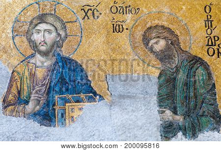 ISTANBUL, TURKEY - OCTOBER 30, 2015: Deesis - Byzantine mosaic in Hagia Sophia church, showing Jesus Christ and John the Baptist (Ioannes Prodromos), probably dates from 1261