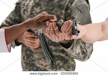 People Holding Soldiers Rifle