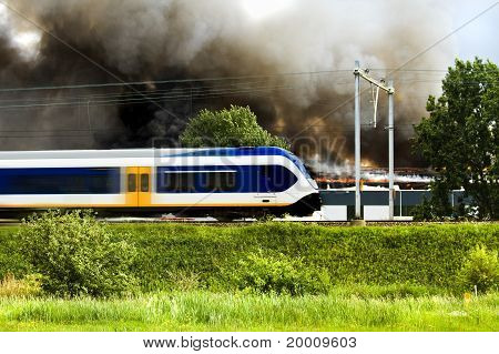Big Fire In Factory And Train Passing By