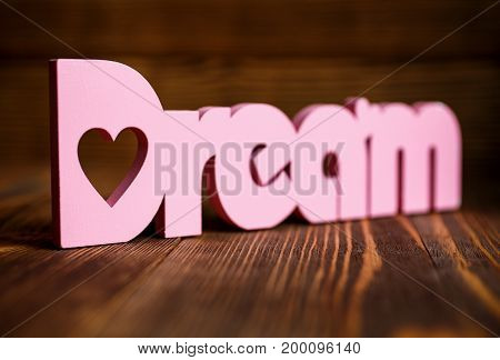 Dream wooden letters on wooden background. Dream wooden word. place for text