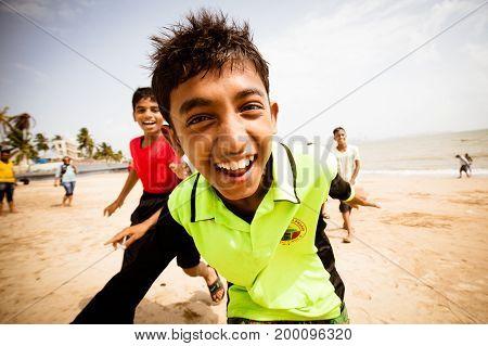 Mumbai, India - 5 August:  Children happily play on Girgaum Chowpatty beach in Mumbai on 5th August 2017.