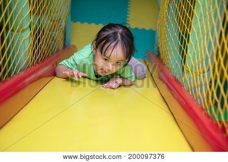 Asian Chinese Little Girl Playing Slide