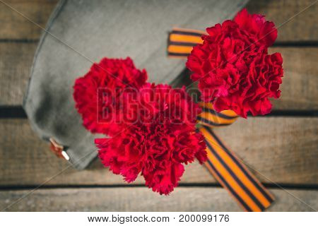 Carnation Flowers, George Ribbon And Military Garrison Cap With A Red Star. May 9 Victory Day
