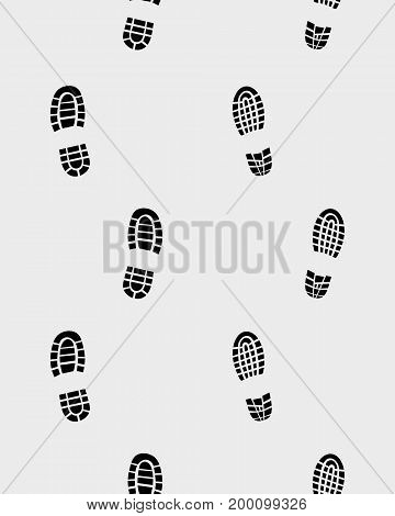 Prints of shoes on the gray background, seamless