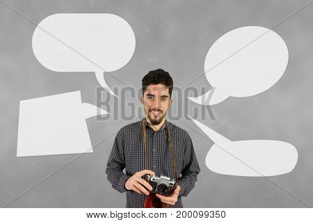 Digital composite of Photographer man with speech bubbles against grey background