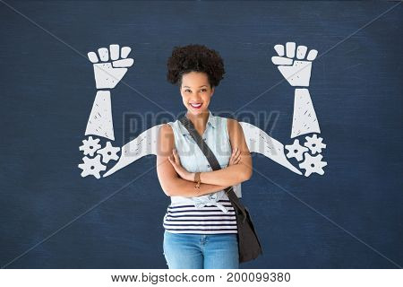 Digital composite of Student woman with fists graphic standing against blue blackboard