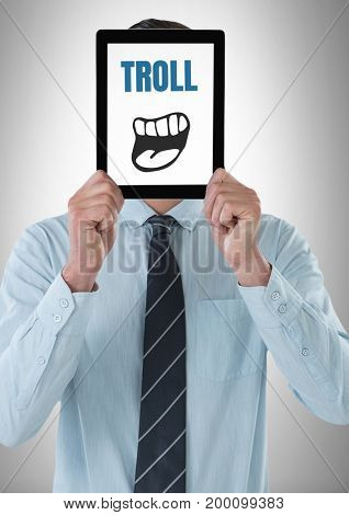 Digital composite of Troll text with cartoon mouth on tablet over mans face