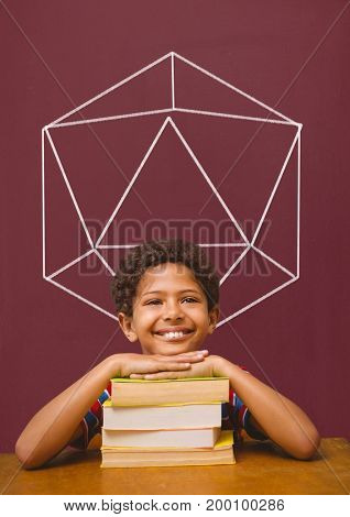 Digital composite of Student boy at table against red blackboard with school and education graphic
