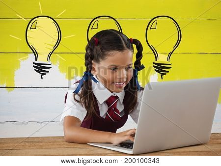 Digital composite of Schoolgirl on laptop with light bulbs on painted yellow wall