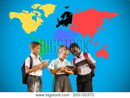 Digital composite of School kids looking at tablets in front of colorful world map