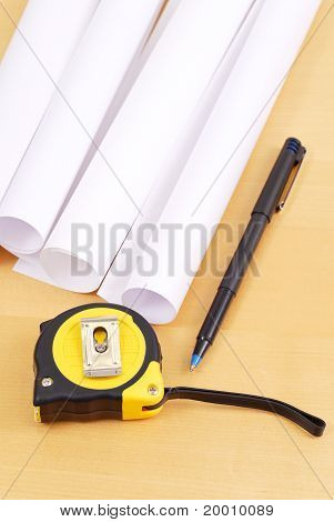 Tape Measure With Pen And Blue Prints