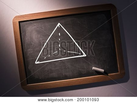 Digital composite of pyramid on blackboard