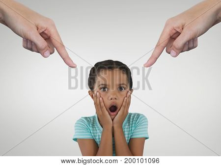 Digital composite of Hands pointing at surprised girl against white background