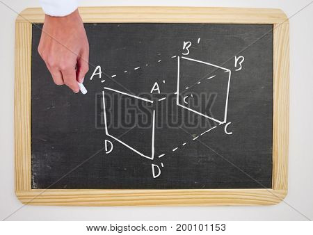 Digital composite of Hand writing with chalk on blackboard
