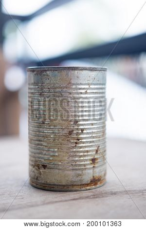Old empty canned food on wood table