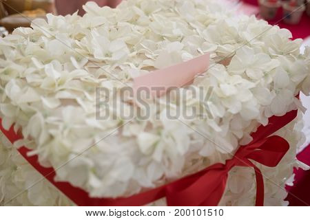 Box for wishes and money for wedding decoration with white flower