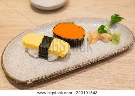 Sushi shrimp eggs and egg sushi tamago sushi on dihs