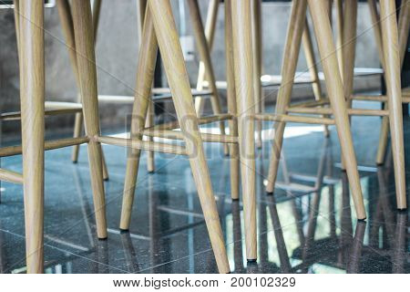 Legs chair in coffee cafe with reflection on the floor.