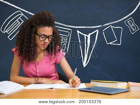 Digital composite of Student girl at table writing against blue blackboard with school and education graphic