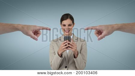 Digital composite of Hands pointing at happy business woman using her phone against blue background