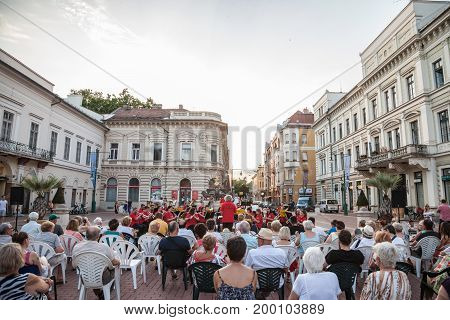 SZEGED HUNGARY - JULY 22 2017: Street concert performed in the city center of Szeged Hungary at sunset by the local classical music band