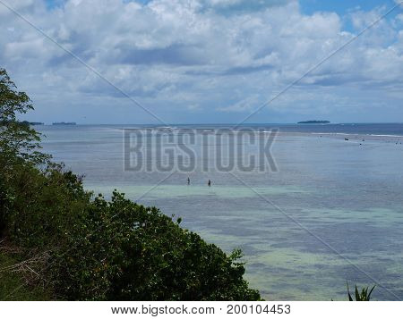 Coastal view of the northern part of Saipan with Managaha Island in the far distance