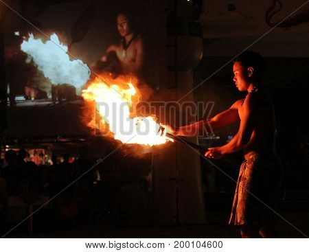 SAIPAN, CNMI--Male fire dancers perform before an audience of locals and tourists at one of the regular weekly street markets in Garapan, Saipan in December 2016.