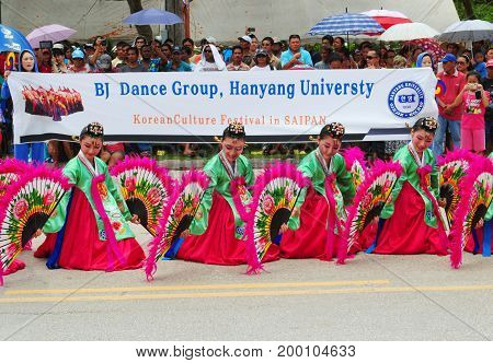 SAIPAN, CNMI--The BJ Dance Group from Korea, a regular visitor to the island performs at the Liberation Parade in Saipan with their fan dance and colorful costumes in July 2015.