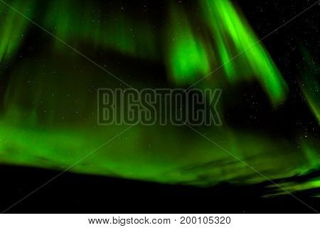 A beautiful green Aurora borealis or northern lights Norway