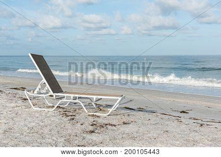 Lounge chair on Sand Key Beach, Pinellas County, Florida, USA
