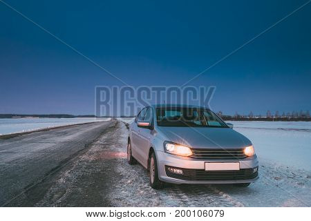 Car Sedan Parking On A Roadside Of Country Road On A Background Of Blue Sky At Winter Season.