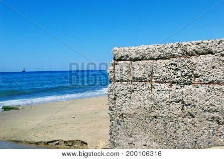 Concrete construction of storm water sewerage on the beach of Cleopatra Beach (Alanya, Turkey).