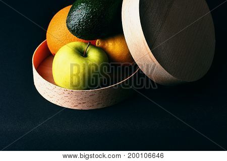Various Fruits: Lemon, Apple, Orange, Avocado On Grey Table