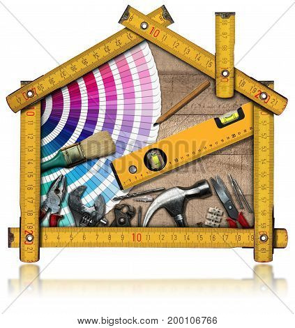 Home improvement concept - Yellow wooden meter ruler in the shape of a house with work tools. Isolated on white background